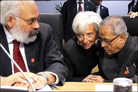 From L-R: RBI deputy Governor Subir Gokarn, IMF head Christine Lagarde and Finance Minister Pranab Mukherjee.