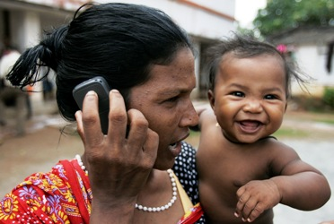 A woman speaks on a mobile phone at a refugee camp in Bhubaneswar.