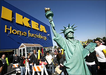 A woman dressed as the Statue of Liberty attends the grand opening of the Ikea home furnishing store.