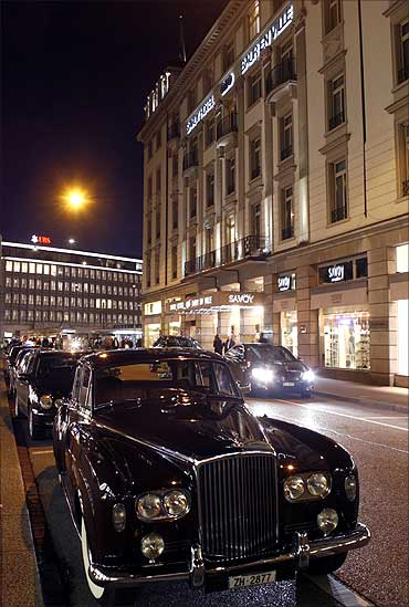 A vintage Bentley limousine is parked in front of the Savoy Hotel Baur En Ville in Zurich.