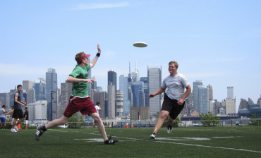 With the New York skyline behind them, people play a game of ultimate frisbee in Weehawken, New Jersey.