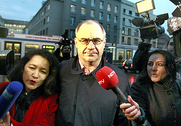 Members of the media surround former Swiss private banker Rudolf Elmer in Zurich.