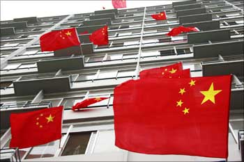 China's flags are displayed outside a dormitory building at the Beijing Institute of Technology.