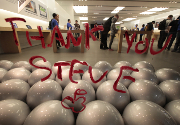 A tribute message written in lipstick is seen on the window of the Apple Store in Santa Monica, California.