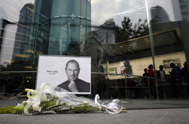 Flowers laid outside an Apple Store in downtown Shanghai.