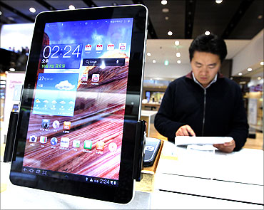 A man uses Samsung Electronics' tablet Galaxy Tab 10.1 displayed for customers.
