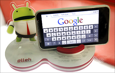 An Android smartphone displays the Google website.