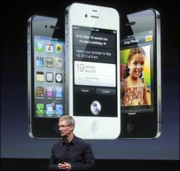 Apple CEO Tim Cook speaks in front of an image of an iPhone 4S at Apple headquarters in Cupertino, California.