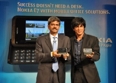 D Shivakumar of Nokia India with Shahrukh Khan at the launch of Nokia's dual SIM phones