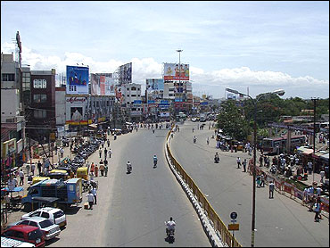 Dr Nanjappa road opposite Gandhipuram Bus Stand.