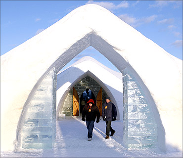 Visitors walk out of Ice Hotel in Quebec.