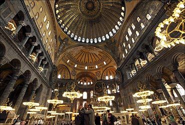 A Macedonian couple takes pictures as they visit the Byzantine monument of Hagia Sophia in Istanbul.