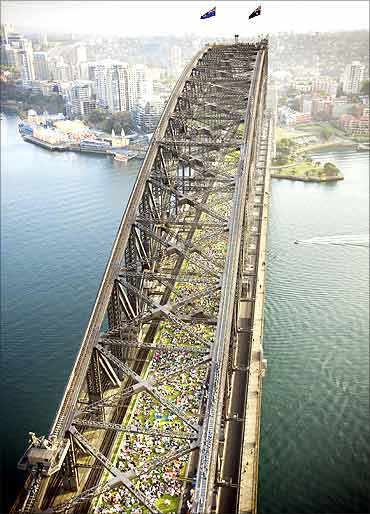 People eat breakfast at the Sydney Harbour Bridge in Central Sydney.