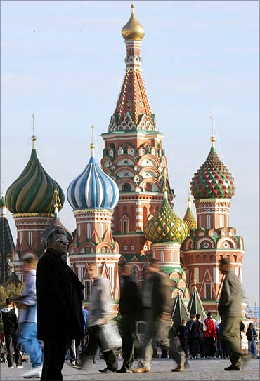 A tourist stands in front of St Basil's cathedral on Moscow's Red Square.