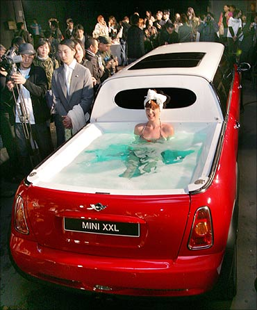 A model soaks in a jacuzzi on the rear end of a limousine named Mini XXL.