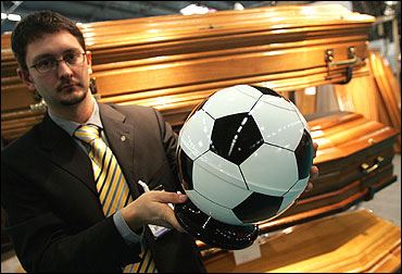 A funeral urn in the form of a soccer ball.
