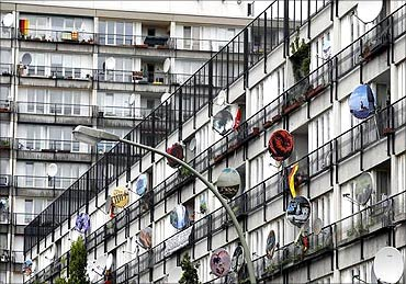 Painted satellite dishes at an apartment building.