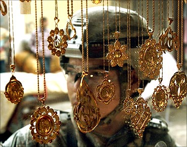 A US soldier passes a jewellery shop during a patrol in Baquba.