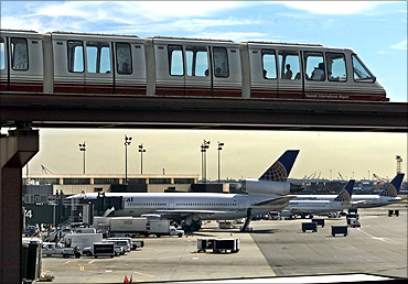 A monorail train runs past Continential Airlines jets at the Continental Airlines terminal at Newark International Airport in Newark.