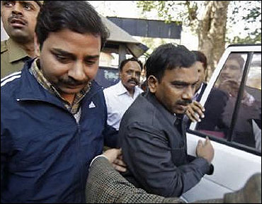(Former telecom minister A Raja (C) arrives at a court for a hearing in New Delhi.