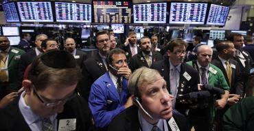 Traders work on the floor of New York Stock Exchange.