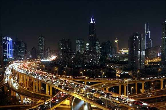 Vehicles drive on flyovers during the evening rush hour in central Shanghai.