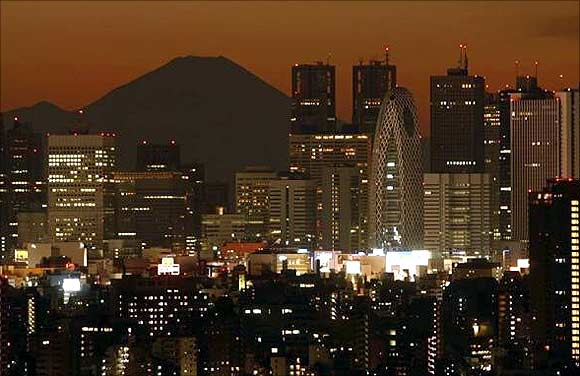 Mt. Fuji, is seen through skyscrapers in Tokyo.