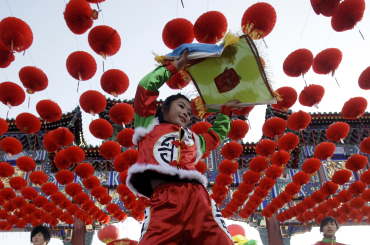 A dancer performs during the opening ceremony of the Spring Festival Temple Fair at the Temple of Earth park in Beijing.