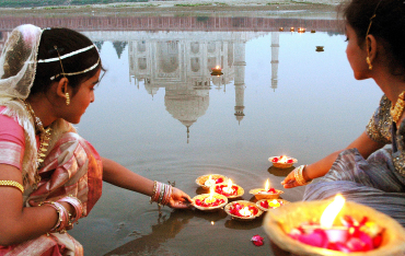 Women light 'diyas' near Taj Mahal in Agra.