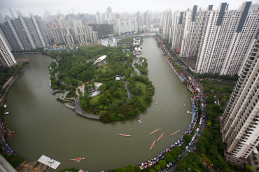 Boats participate in dragon race to celebrate Dragon Boat Festival on Suzhou river in Shanghai.
