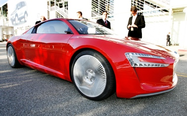 An Audi E-tron electric concept car alternative fuel vehicle is seen on display during a preview.