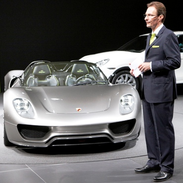 CEO Michael Macht of German car manufacturer Porsche stands beside a Porsche 918 Spyder car.
