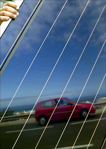 A car is reflected on a solar panel in Santa Cruz de Tenerife in Spanish Canary Island of Tenerife.