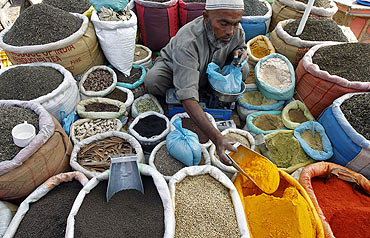 A vendor sells spices on a street in Srinagar.
