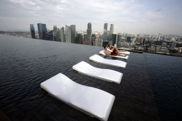 A view of the infinity pool of the Skypark that tops the Marina Bay Sands hotel towers.