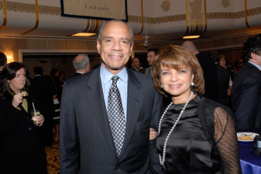 Ken Chenault, pictured here with his wife, saw a dip in compensation.