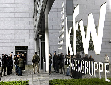 Journalists wait outside the local branch of the KfW bank in Frankfurt.