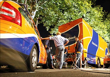 Rabobank team personnel stand by team vehicles in the Mercure Hotel car park in Pau.
