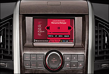 An iPod-compatible music system. A fully loaded navigation system. A 6-inch colour, touchscreen infotainment display.