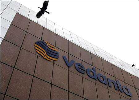 A bird flies by the Vedanta office building in Mumbai.
