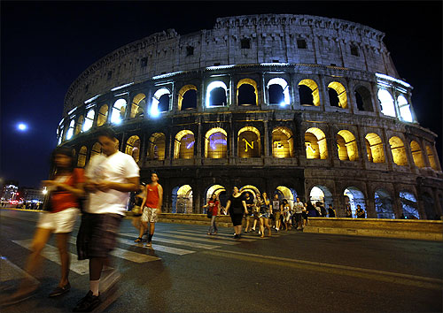 Rome's ancient Colosseum is lit up.