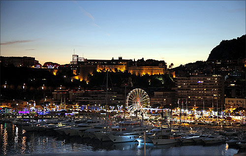 Monaco palace (top) and the port of Monaco are seen at sunset.