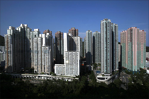 Sunlight is reflected on a window as private and public residential buildings are seen in Po Lam, a satellite town in Hong Kong.
