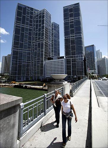 People walk past the Icon Brickell condo, billionaire Jorge Perez's latest project, in downtown Miami, Florida.