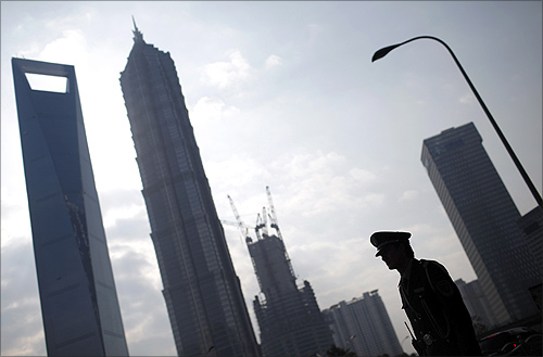 A security guard stands in the financial district of Pudong in Shanghai.