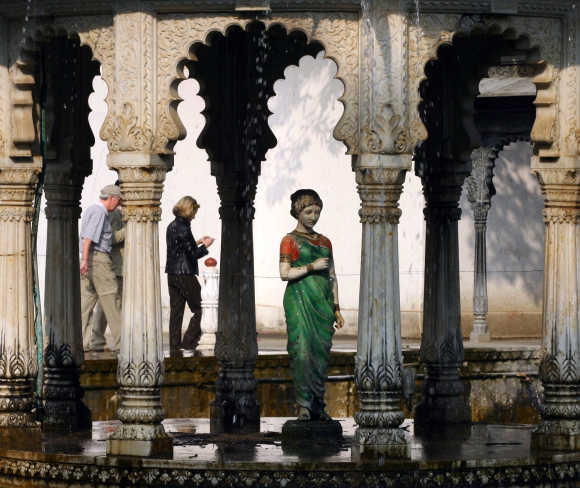 Tourists walk in 'Saheliyon-Ki-Badi' garden in Udaipur, Rajasthan. Saheliyon-Ki-Badi is an ornamental garden built by Sangram Singh II in 1710.