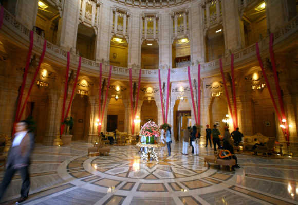 Guests walk through the lobby of Umaid Bhawan Palace also operating as a five-star deluxe hotel in Jodhpur, Rajasthan. The palace is named after Maharaja Umaid Singh, grandfather of the present Maharaja of Jodhpur, this monument has 347 rooms and also serves as the residence of the Jodhpur royal family.