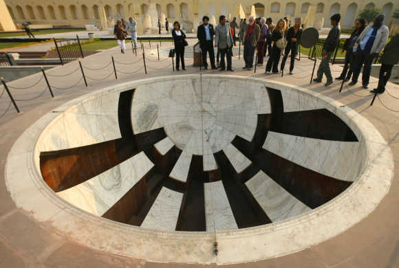 Tourists visit Jantar Mantar, a collection of architectural astronomical instruments, in Jaipur, capital of Rajasthan. The name Jantar Mantar is derived from instrument for formula on context calculation as this observatory consists of 14 major geometric devices for measuring time, predicting eclipses, tracking stars in their orbits, ascertaining the declinations of planets, and determining the celestial altitudes and related ephemeredes.