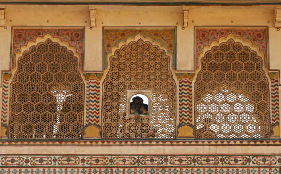 Tourists visit the Amber Fort in Jaipur, Rajasthan. The structure known as Amber Fort contains several spectacular buildings and is actually the palace built by the great conqueror Raja Man Singh I who ruled from 1590-1614 AD.