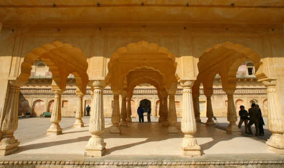 Tourists stand at the Amber fort in Jaipur, Rajasthan.